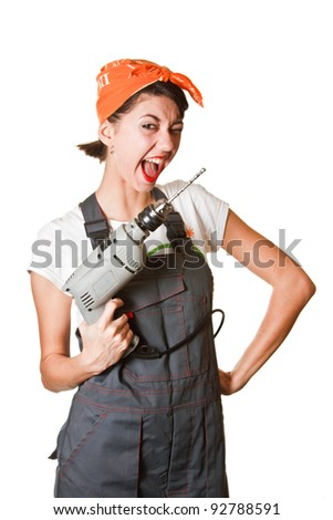 Laughing girl with drill isolated on white background - stock photo