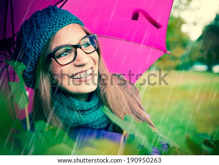 laughing girl with pink umbrella - stock photo