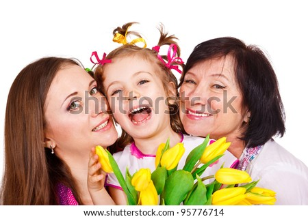 Laughing grandmother with her daughter and granddaughter - stock photo