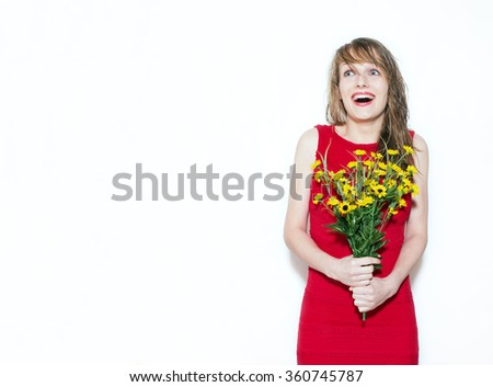 Laughing happy girl with a bouquet of flowers. Laughing girl in a red dress isolated on white. Young woman surprised. - stock photo