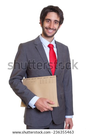Laughing latin businessman with file - stock photo