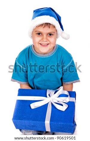 Laughing little boy in Santa's hat with gift boxes isolated on white - stock photo