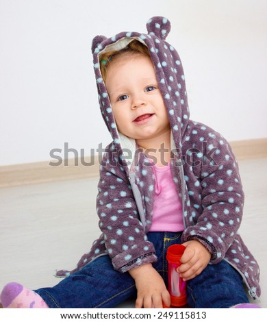 laughing little girl at room - stock photo