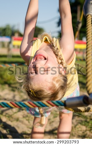 laughing little girl playing in playground - stock photo