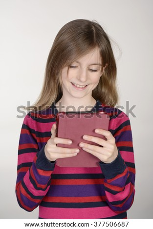 laughing little girl with digital tablet - stock photo