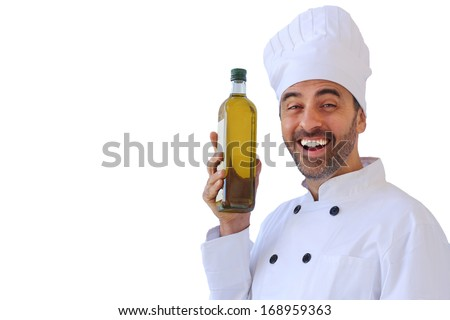 Laughing male chef or baker in a white toque and uniform holding up a bottle of healthy olive oil, isolated on white - stock photo