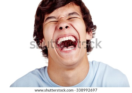 Laughing out loud young man face closeup - laughter concept - stock photo