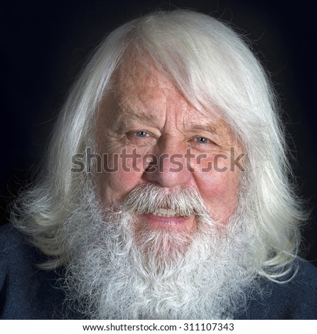 Laughing people, Happy smiling Grandpa, Fairytale Grandfather, Senior artist, Healthy senior,  - the old man laughs as a Moon with a beard - stock photo