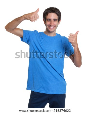 Laughing spanish guy in a blue shirt showing both thumbs up - stock photo