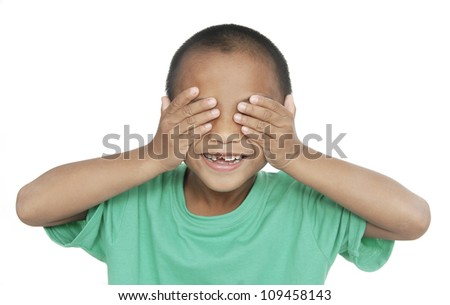 Laughing teenager in a purple sweater shut his eyes with his hands - stock photo