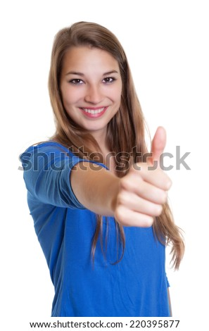 Laughing woman in a blue shirt showing thumb up - stock photo