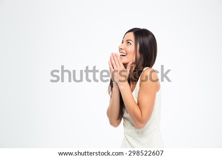 Laughing woman praying isolated on a white background. Looking up - stock photo