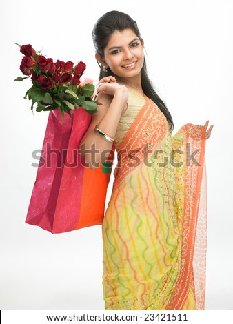 Laughing woman with bag full of red roses - stock photo
