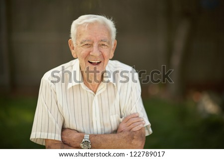 Laughing 90 year old senior elder man outside - stock photo