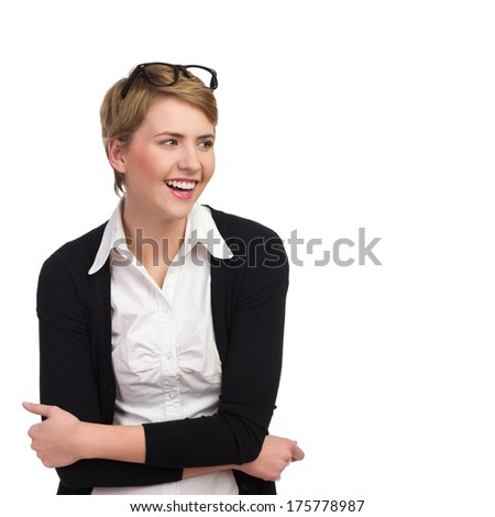 Laughing young woman looking at copy space. Waist up studio shot isolated on white. - stock photo