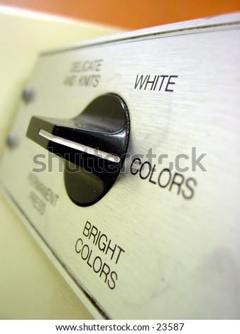 Laundromat washing machine set on colors setting - stock photo