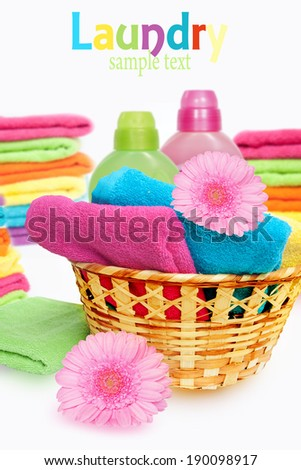 Laundry Basket with colorful towel   - stock photo