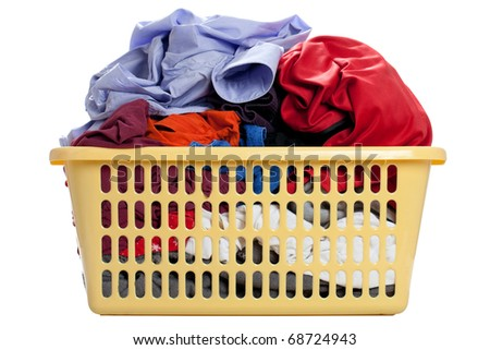 Laundry in a basket - isolated on a white background - stock photo