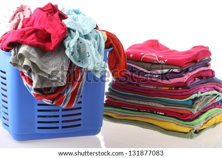 Laundry in basket and ironed clothes, isolated - stock photo