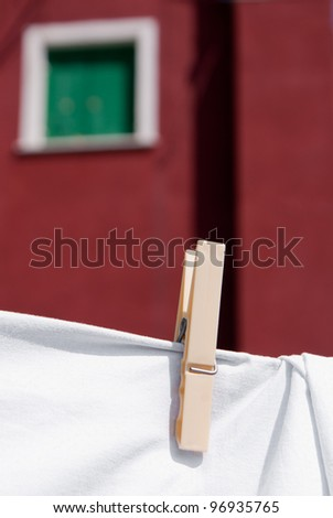 Laundry is hung to dry in an Italian street - stock photo
