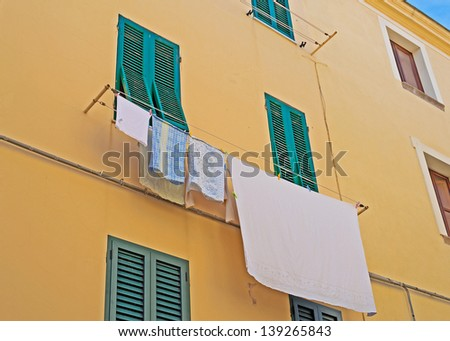 laundry line in a building facade - stock photo