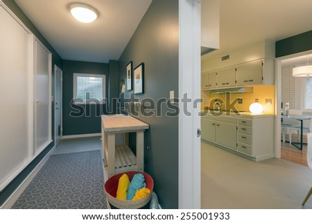Laundry room adjacent to kitchen and dining room.  - stock photo
