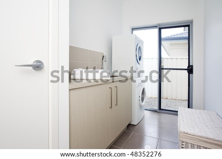 laundry room in modern townhouse - stock photo
