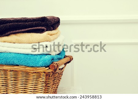 Laundry. Wicker basket with clean towels - stock photo