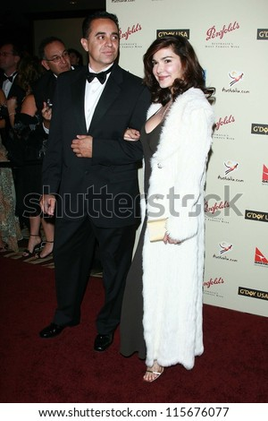 Laura Harring and guest at the G'Day USA Penfolds Black Tie Icon Gala. Hyatt Regency Century Plaza, Los Angeles, CA. 01-13-07 - stock photo
