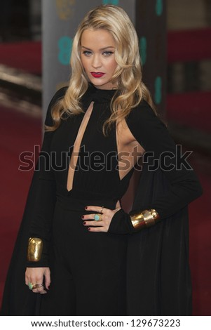 Laura Whitmore arriving for the EE BAFTA Film Awards 2013 at the Royal Opera House, Covent Garden, London. 10/02/2013 Picture by: Simon Burchel - stock photo