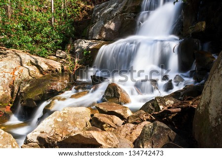 Laurel Falls, a popular waterfall in Great Smoky Mountains National Park, Tennessee, is at the end of a 1.6 mile hike. - stock photo