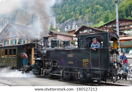 LAUTERBRUNNEN, SWITZELAND - SEPTEMBER 26, 2010 : Nostalgic  steam locomotive at Lauterbrunnen railway station in  Jungfrau region of Switzwland on September 26, 2010.   - stock photo