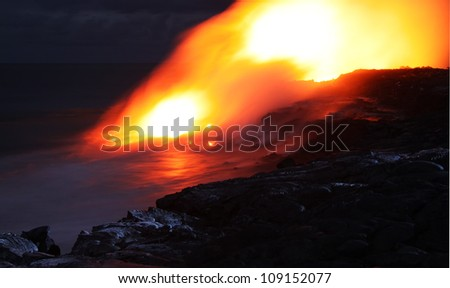 Lava entry in to the ocean at night (Puhi-o-Kalaikini at Big Island, Hawaii) - stock photo