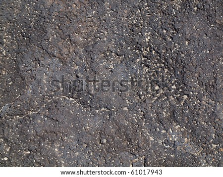Lava rock with bits of sand on top on Oahu's Makapuu beach - stock photo