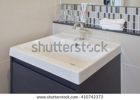 Lavatory and accessories with mosaic wall under the mirror     - stock photo