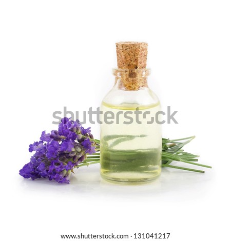 Lavender and essential oil isolated on a white background - stock photo