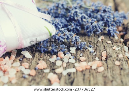 lavender and himalayan salt on wooden surface - stock photo