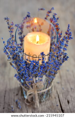 Lavender Candle on old wood  - stock photo