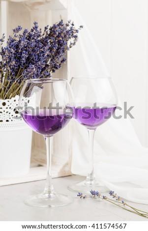 Lavender cocktail on white background. Romantic concept. Shallow focus - stock photo