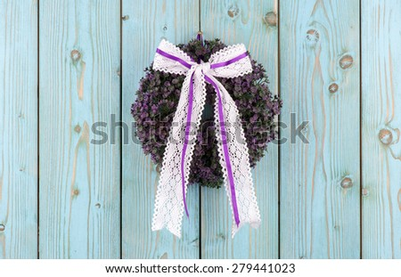 Lavender decorative wreath on the wooden background. - stock photo