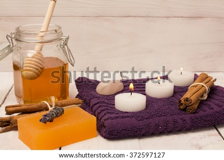 Lavender flower cinnamon, and honey skin treatment  - stock photo