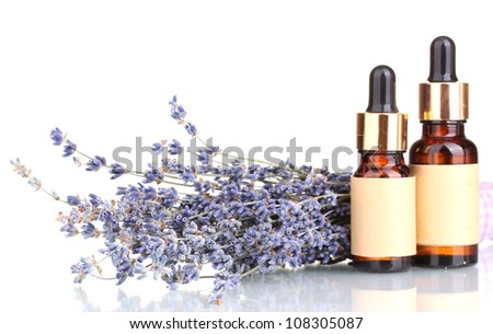 Lavender flowers and aroma oils isolated on white - stock photo