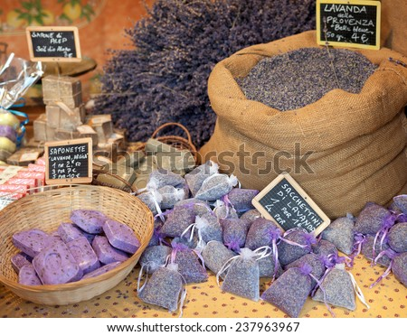 Lavender flowers and sachets filled with dried lavender at market. - stock photo