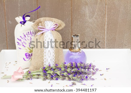 Lavender herbal water in a  bottle, fresh flowers and dry in pouch - stock photo