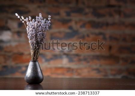 Lavender in metal vase on table - stock photo
