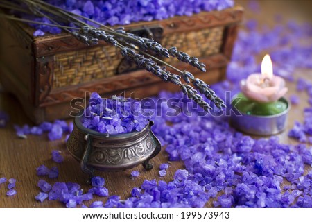 Lavender in vintage silver box, bath salt and candle on the wooden texture - stock photo