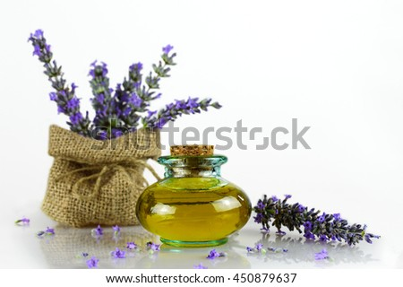 Lavender oil and lavender flowers - stock photo