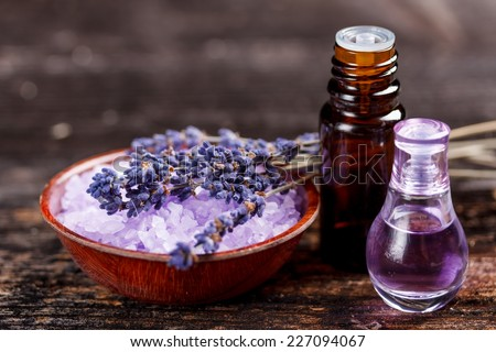 Lavender oil and perfume in a glass bottle - stock photo