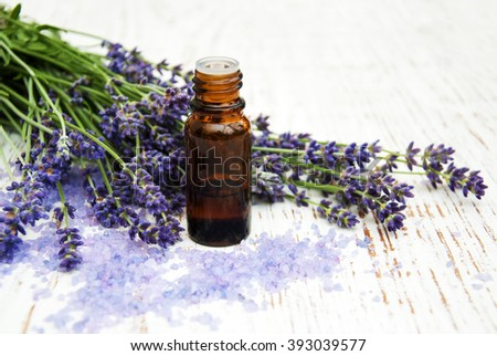 Lavender, sea salt and oil on a wooden background - stock photo