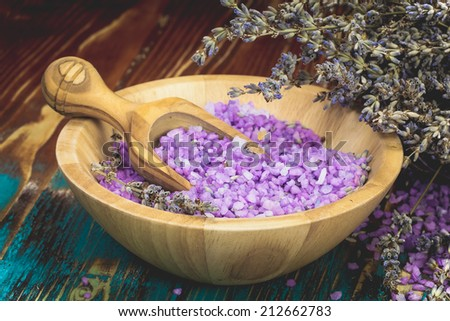 Lavender spa. Bowl of lavender bath salt - beauty treatment. Rustic wooden background. Done with a vintage retro  filter . Macro, selective focus - stock photo